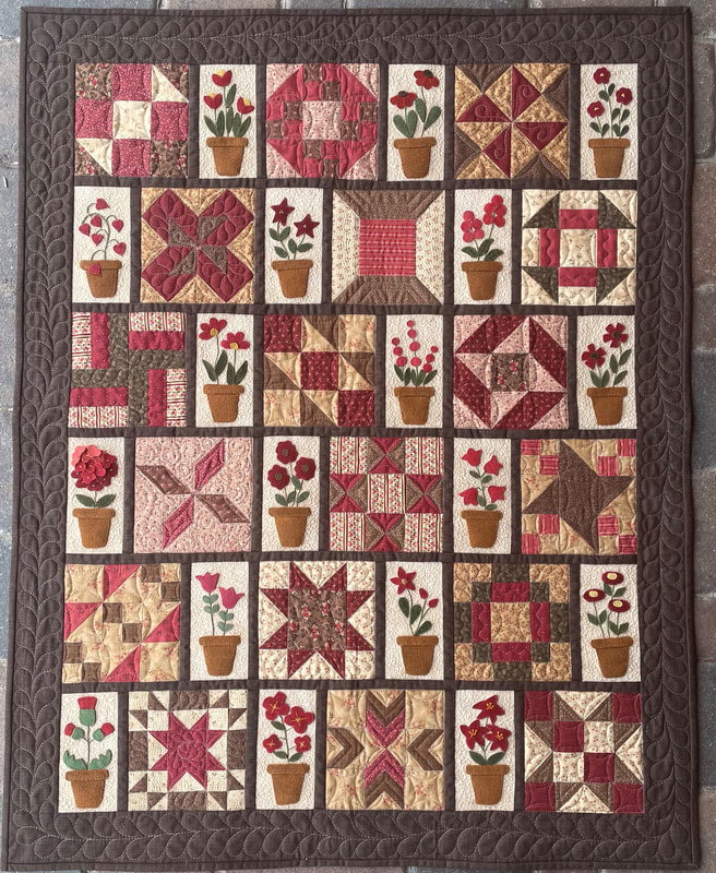 """Friendship Sampler"" a Free Row of the Month (or Row) Quilt Pattern designed by Emily Hardwig from Red Button Quilt Company"